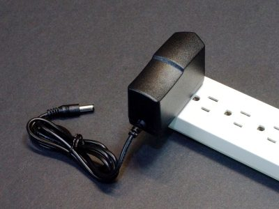 AC Adapter 12V 2A Slim - Plugged into Strip